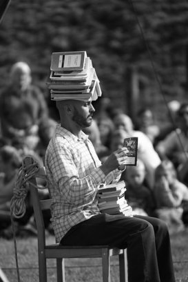 Reading with books on head